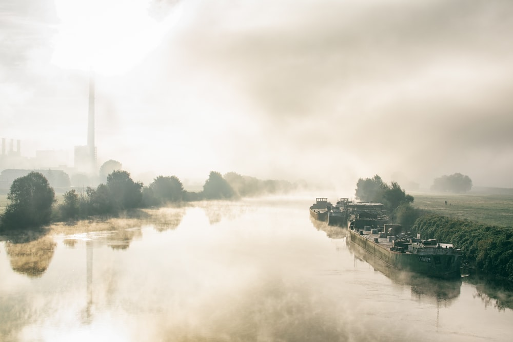 ship on body of water with fogs