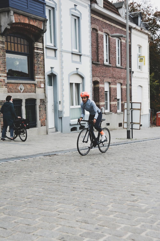 woman riding on bicycle near buldling