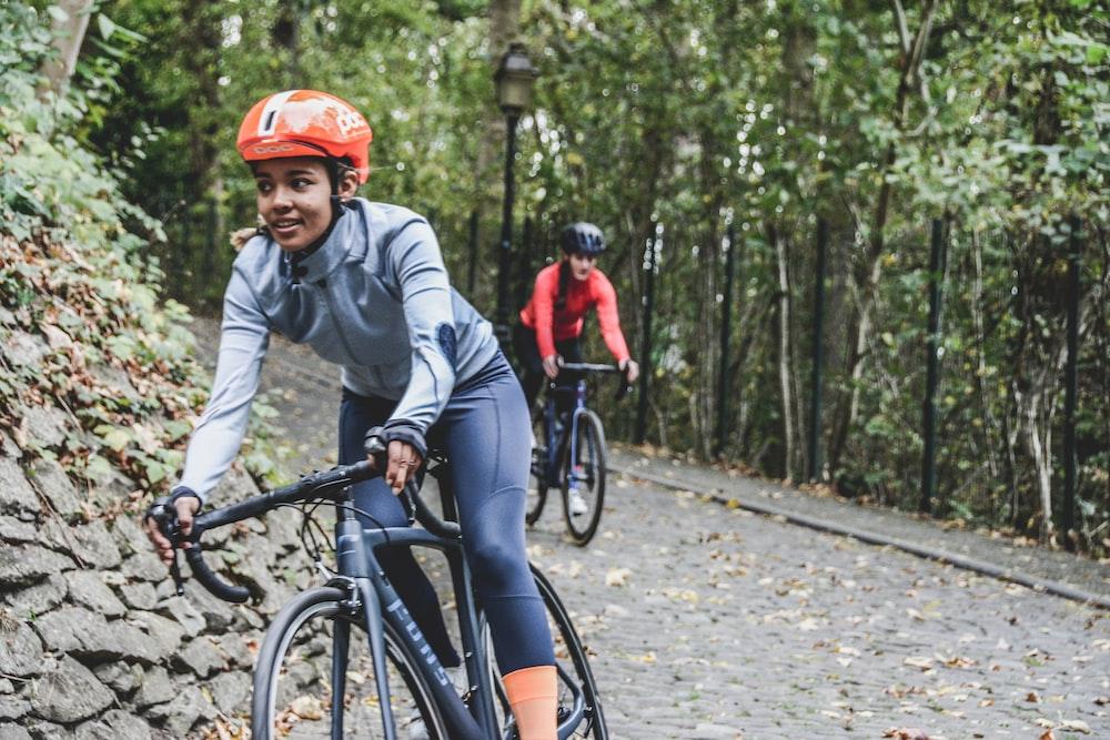 woman biking during daytime