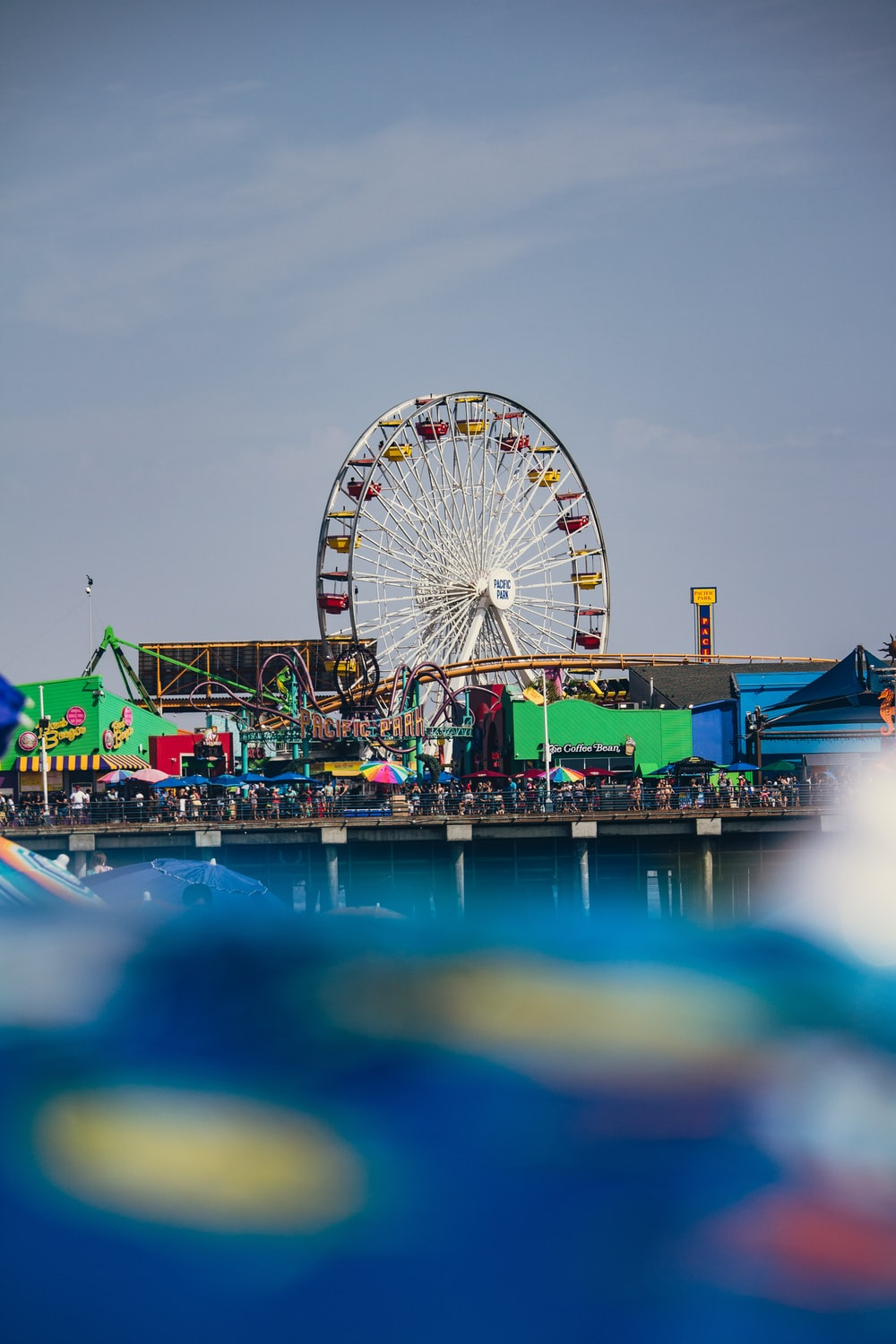 selective focus photography of people near ferris wheel
