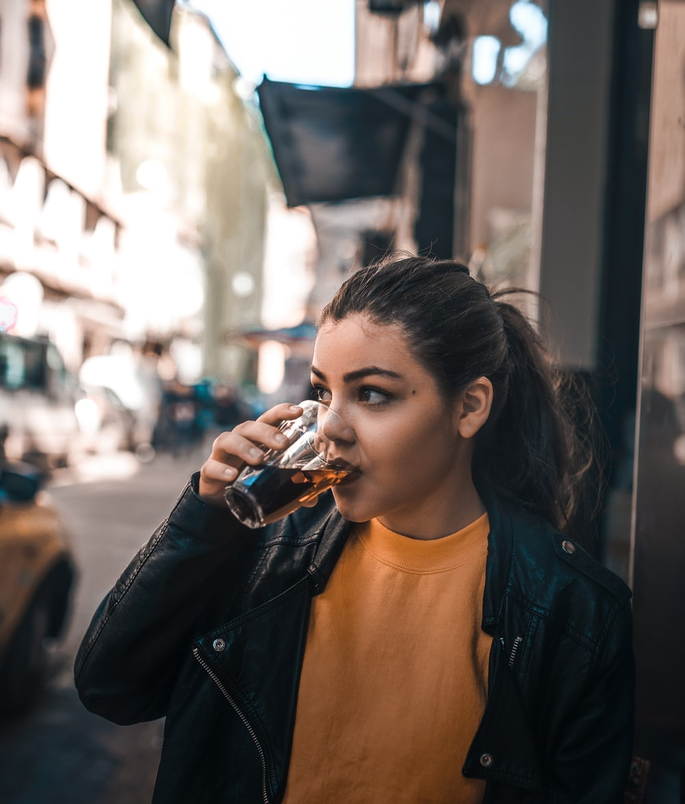 woman drinking in glass