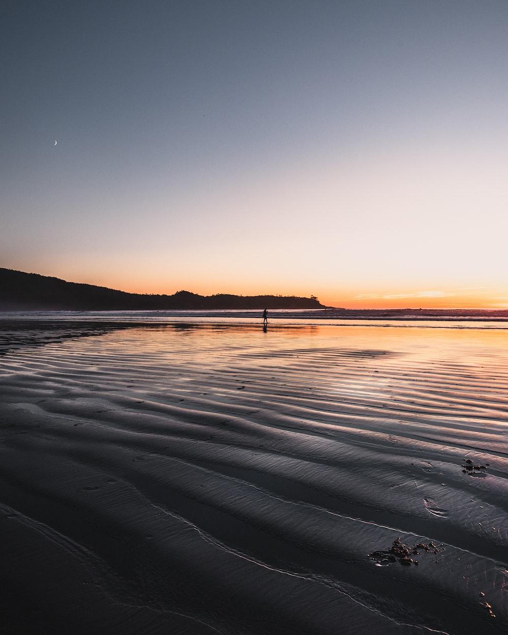 calm ocean during golden hour