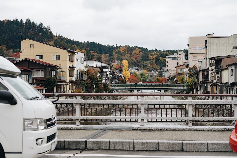 parked white vehicle on bridge