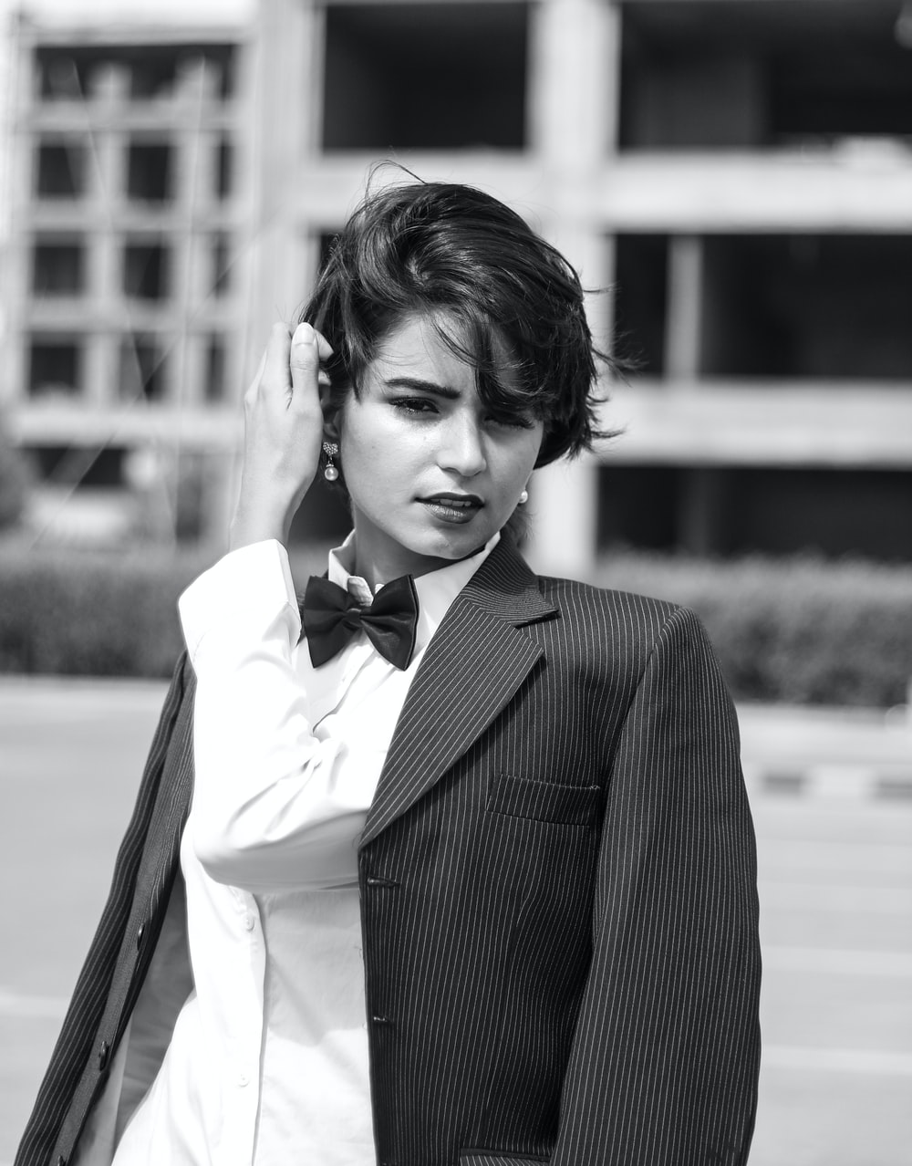 grayscale photography of Lily Collins in suit jacket