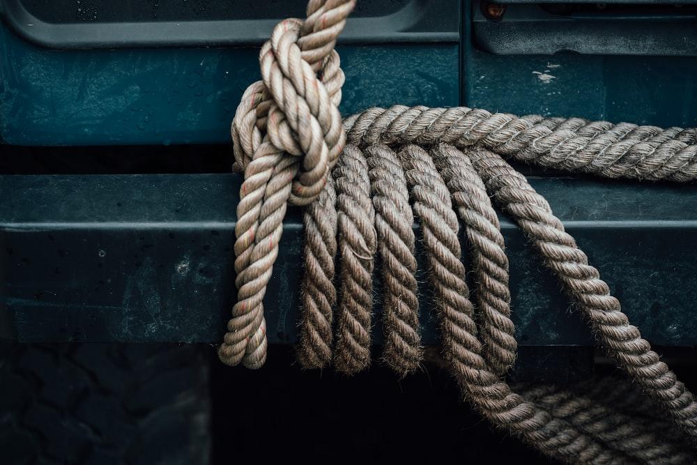 brown rope tied to vehicle