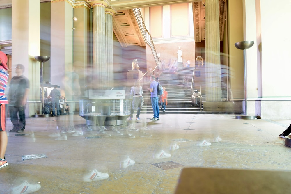 time lapse photography of people inside room