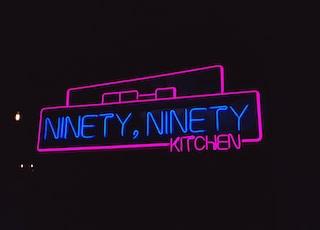 pink and blue Ninety Ninety neon signage