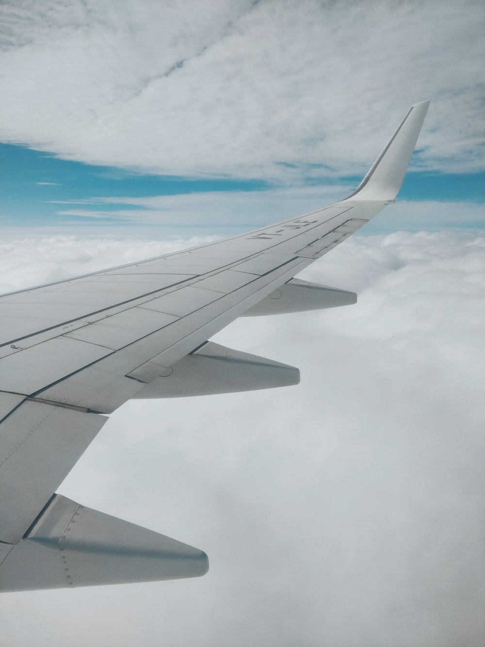 aerial photography of airplane wing and clouds