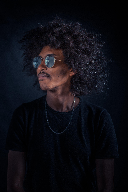 man wearing sunglasses and black shirt