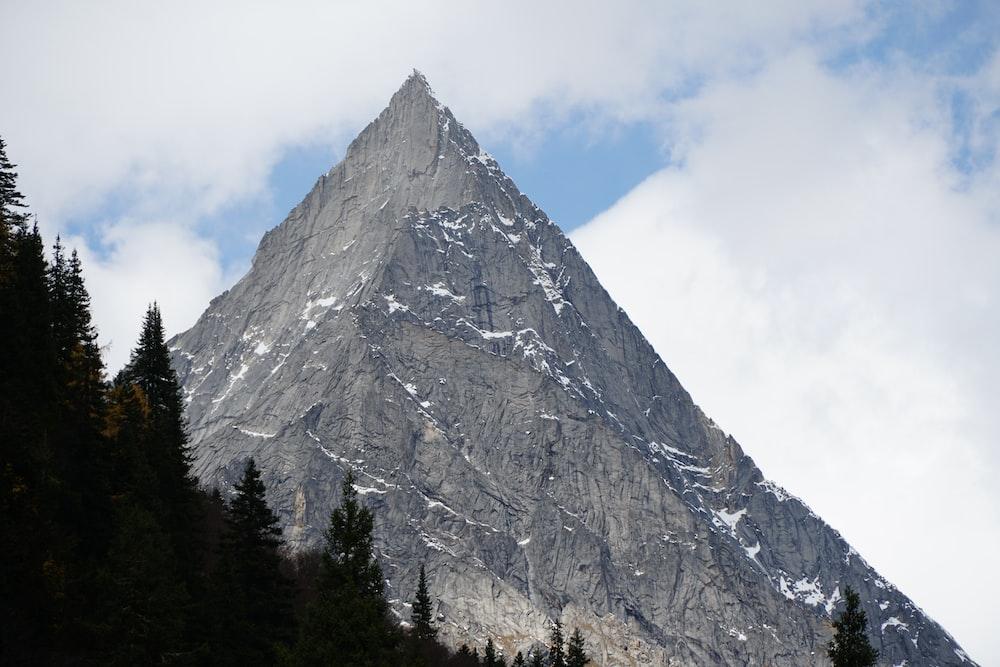 gray mountain under cloudy sky