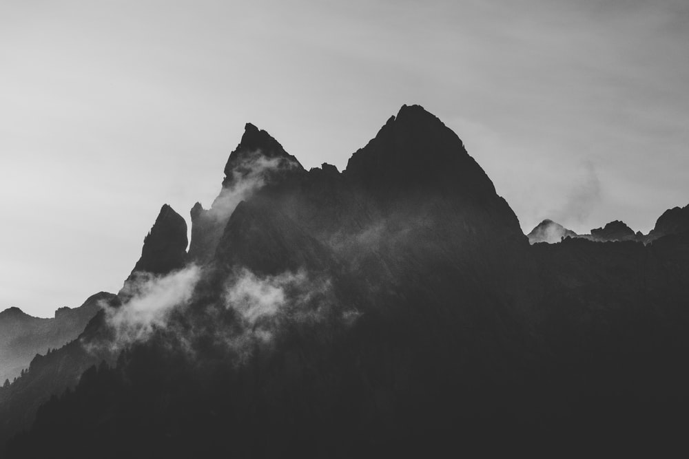 silhouette of pointed mountain