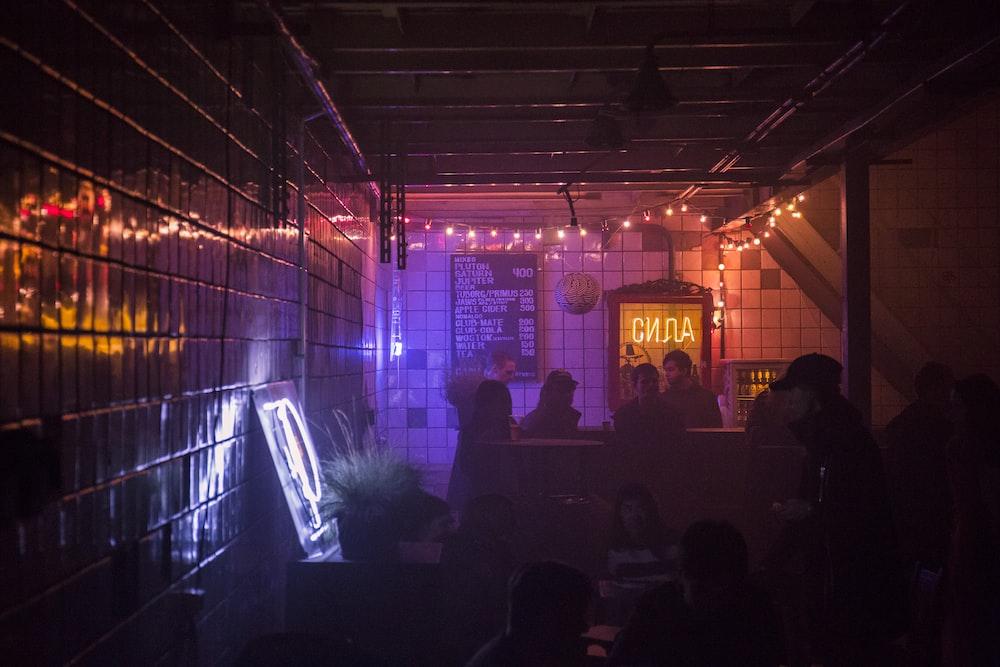 pink and red lighted dark pub interior