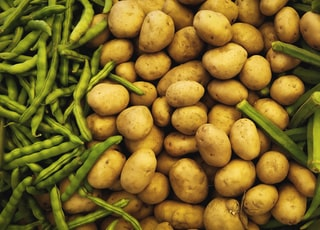 brown potatoes surrounded by green beans