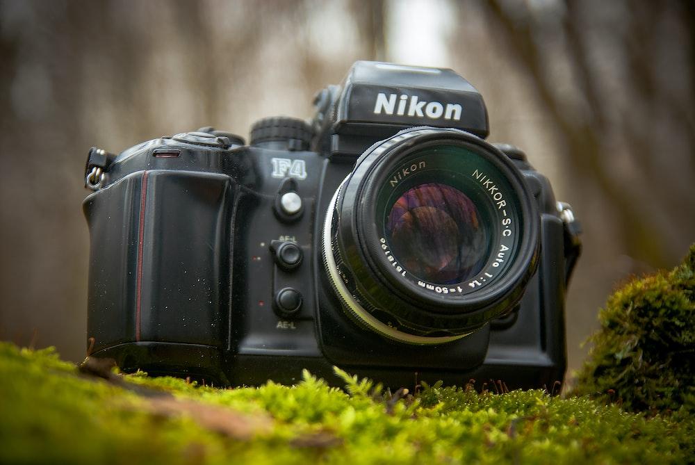close-up photography of black Nikon DSLR camera