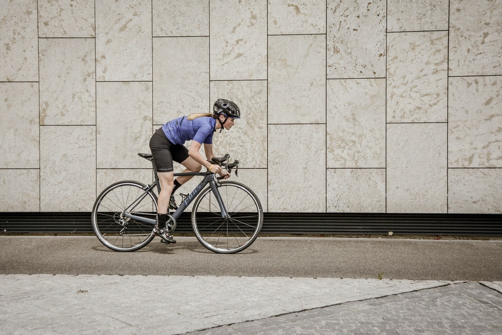 woman riding road bike