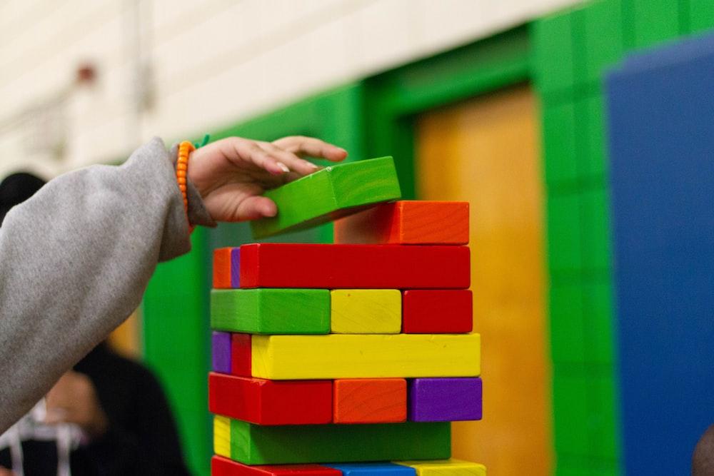 person piling blocks