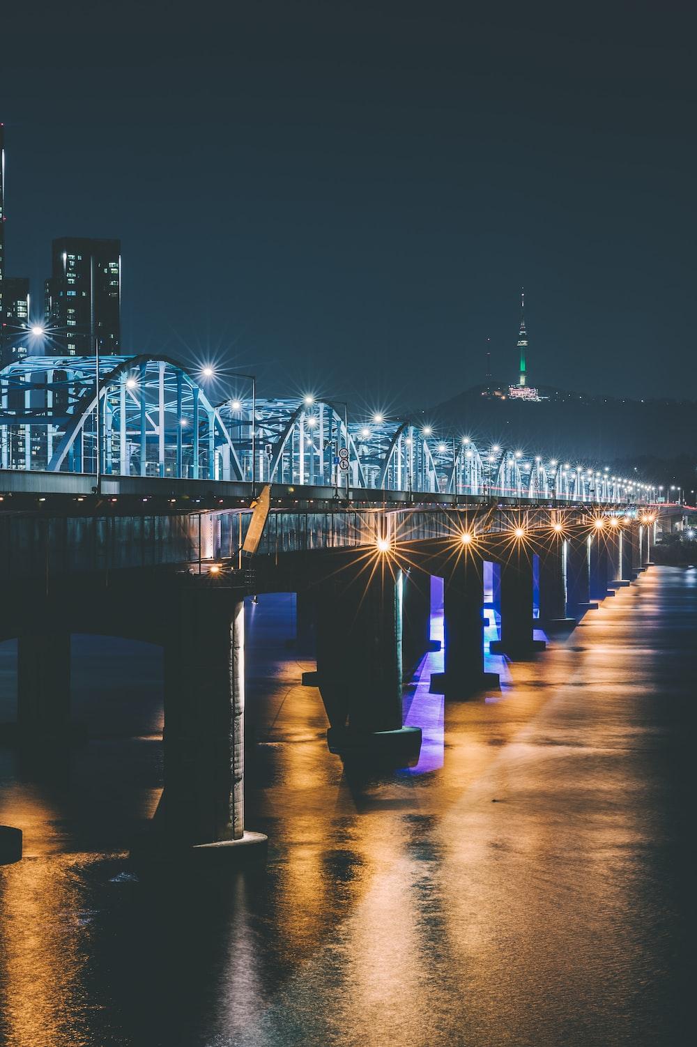 lighted bridge at night time