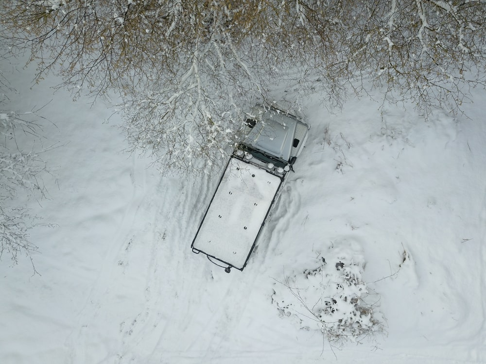 white truck on snow covered ground