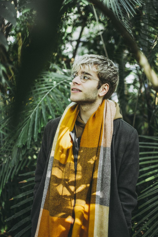 man wearing yellow scarf