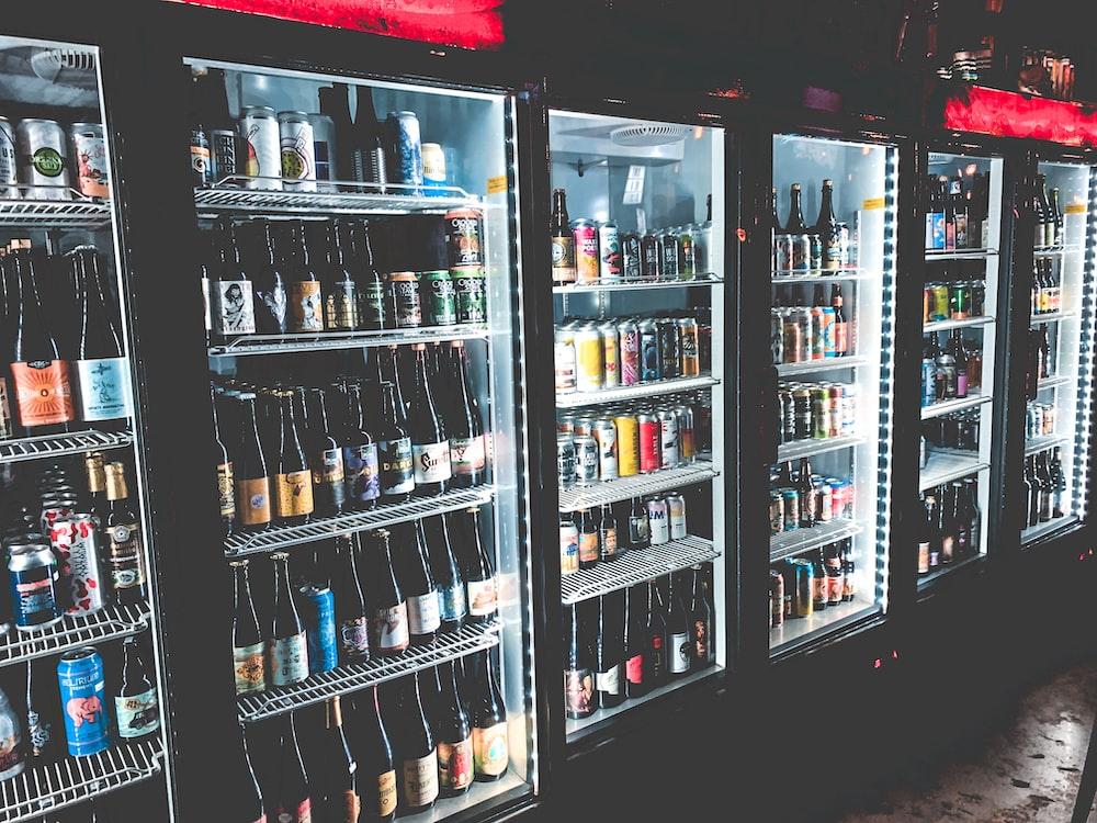 black framed commercial beverage cooler with bottles