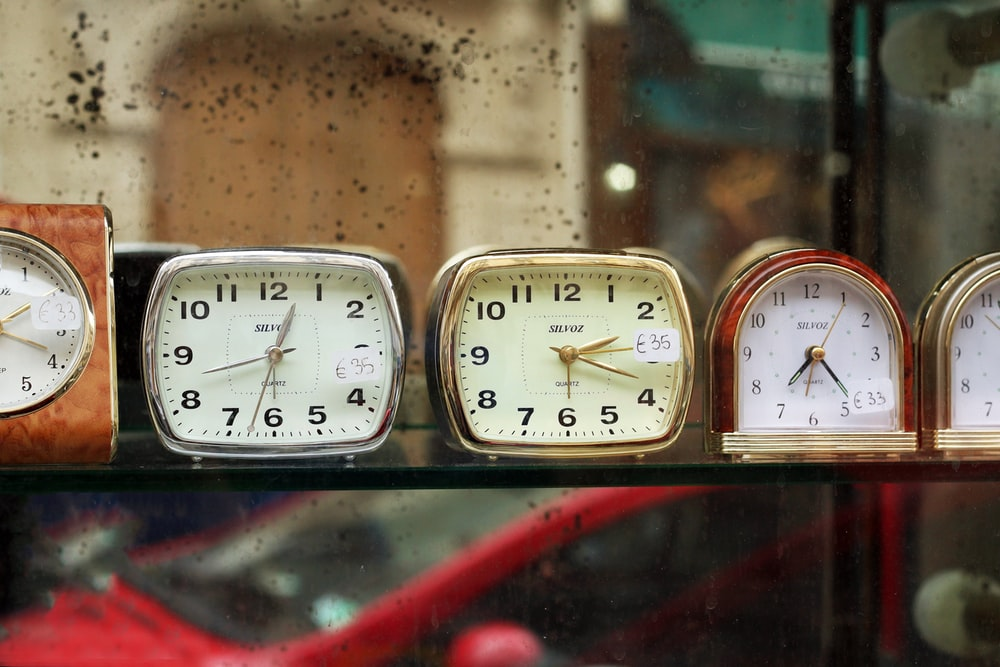 assorted-color analog clocks during daytime photo