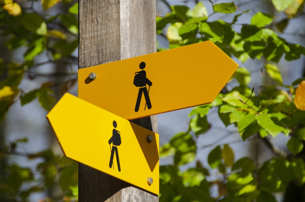 yellow road signage at daytime