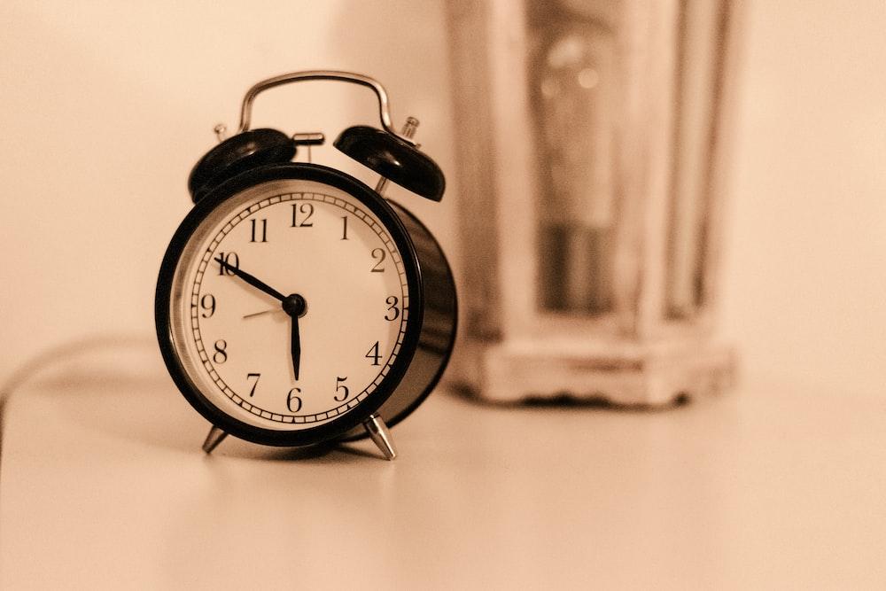 black ring bell alarm clock
