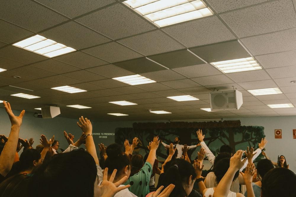 people hand up inside room