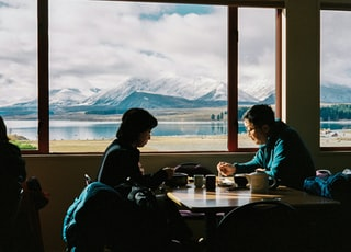 man an woman having breakfast with the view of mountain