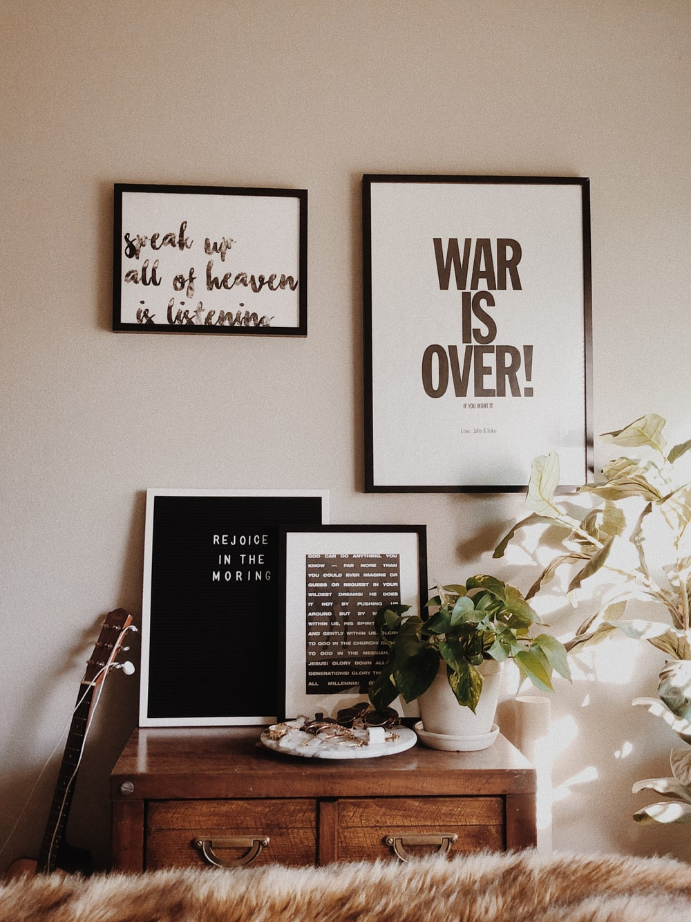 War is Over sign on wall inside room