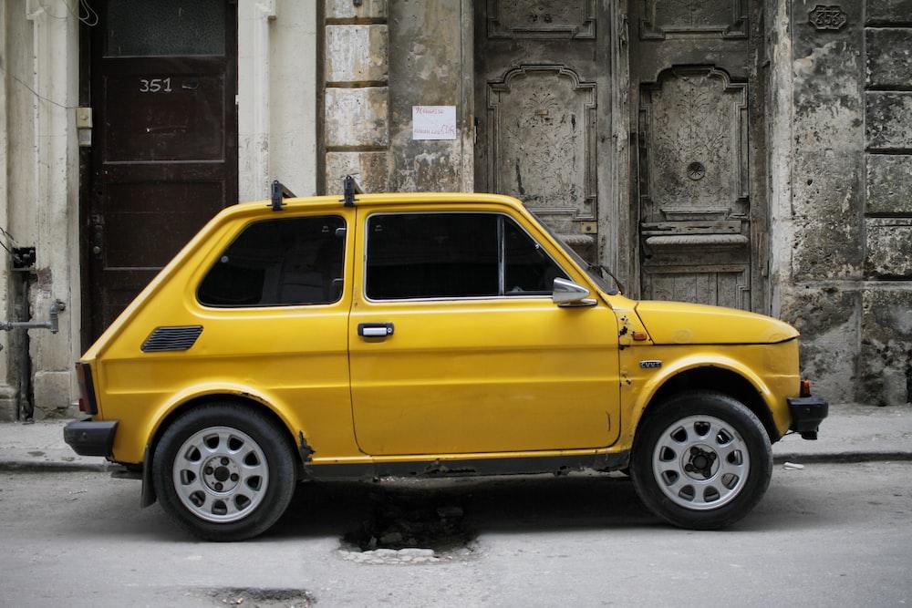 yellow 3-door hatchback