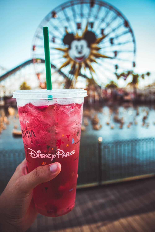 pink Disney Paris drink with green straw