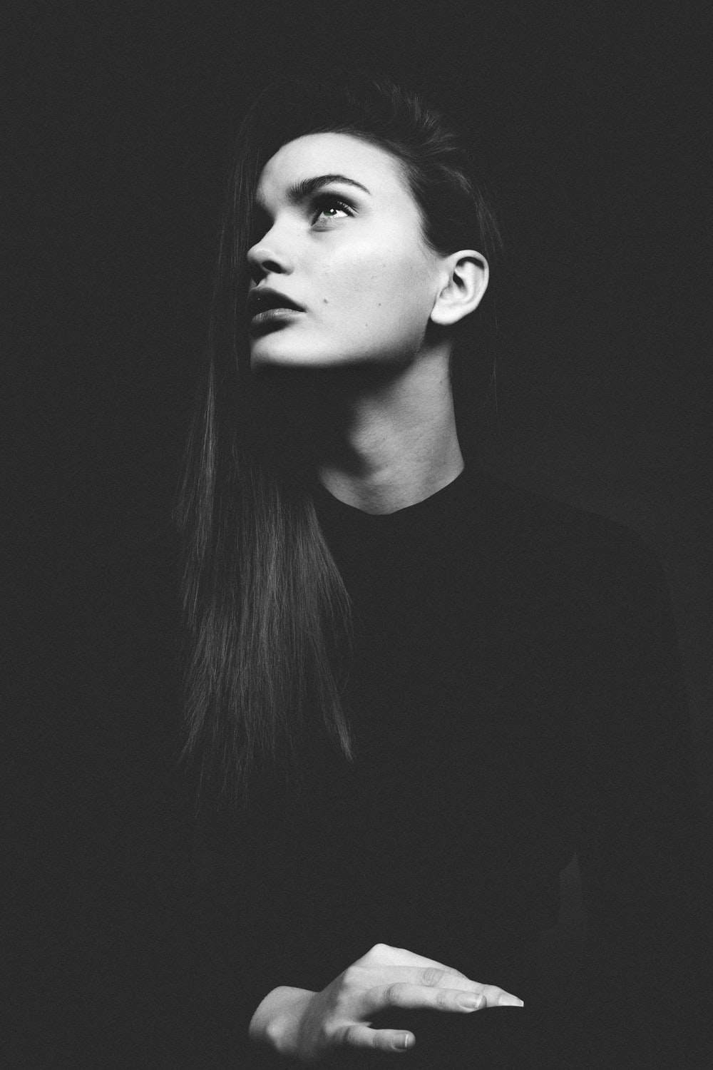 grayscale photo of woman in crew-neck top