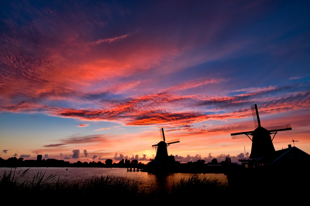 silhouette of two windmills