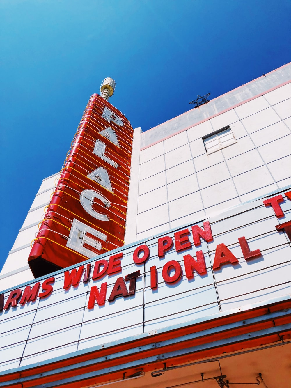 low-angle photography of Palace signage during daytime