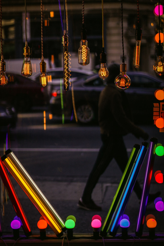 multicolored light bulb mirror frame