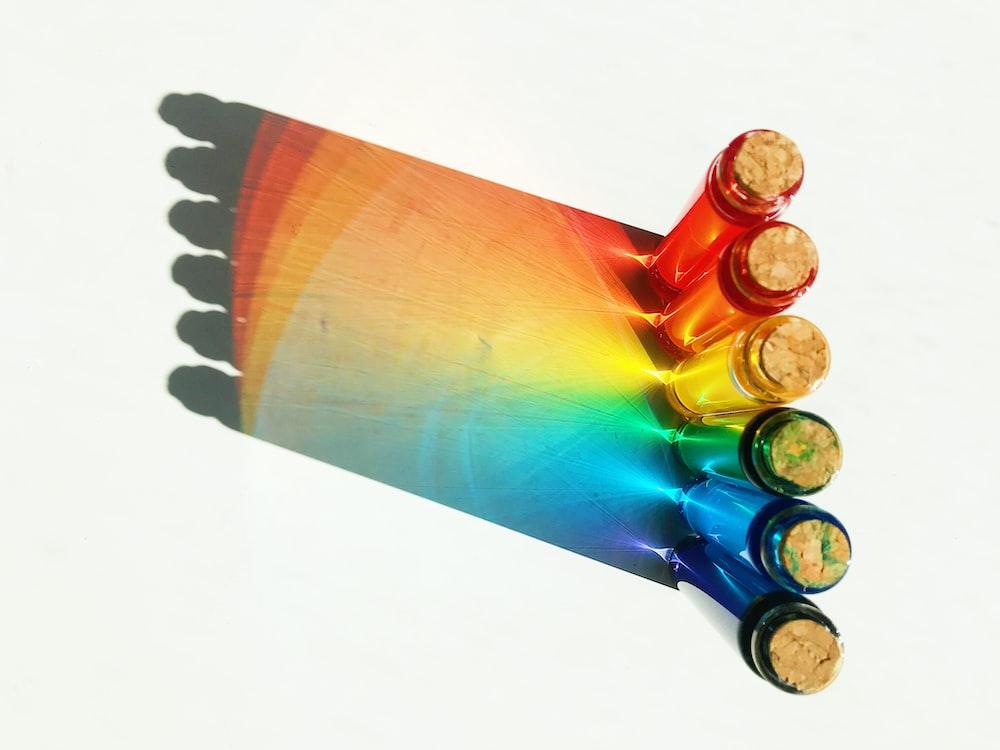 six assorted paint color tubes