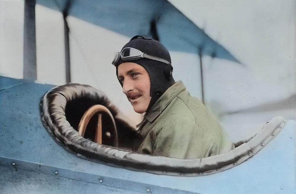 man inside biplane