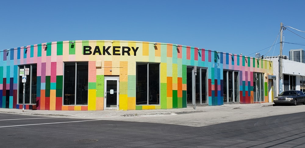 blue, green, and red Bakery shop front under clear blue sky