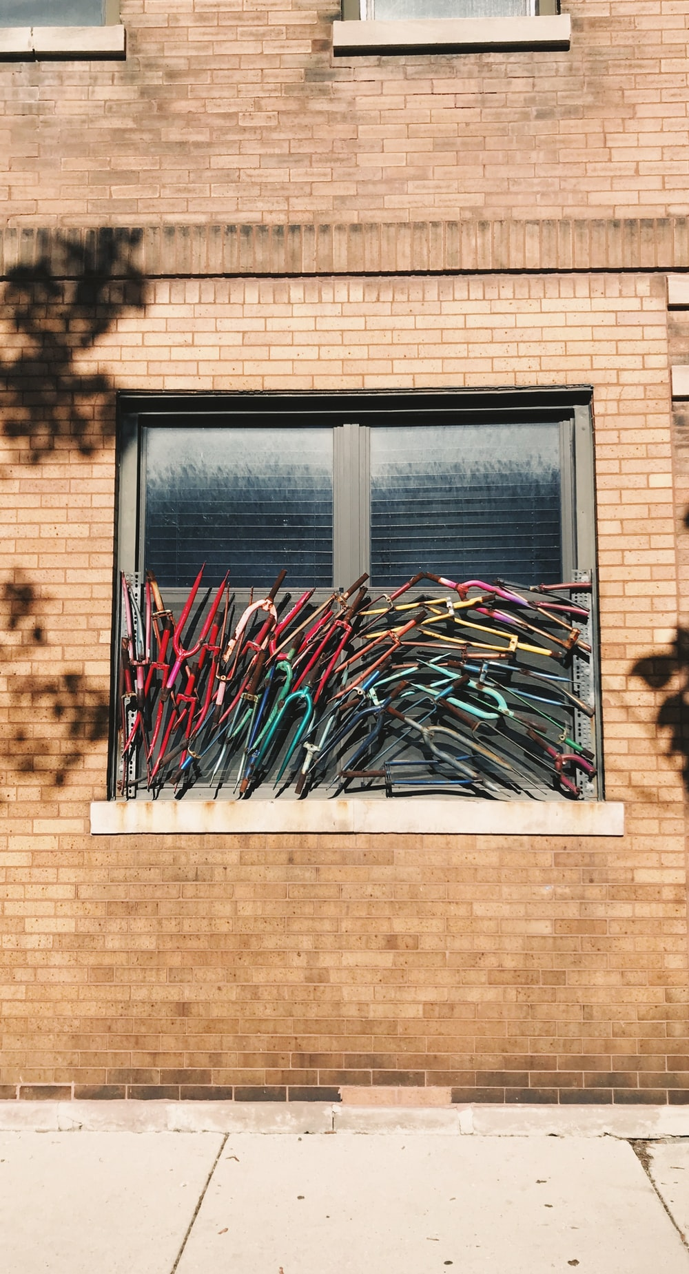 bicycle forks on window