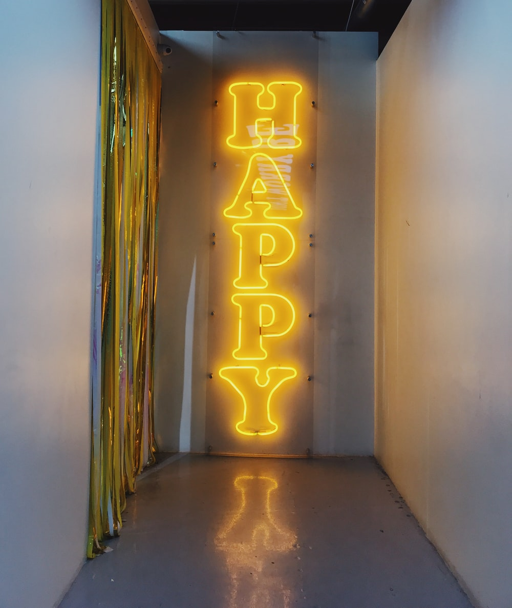 happy neon light signage