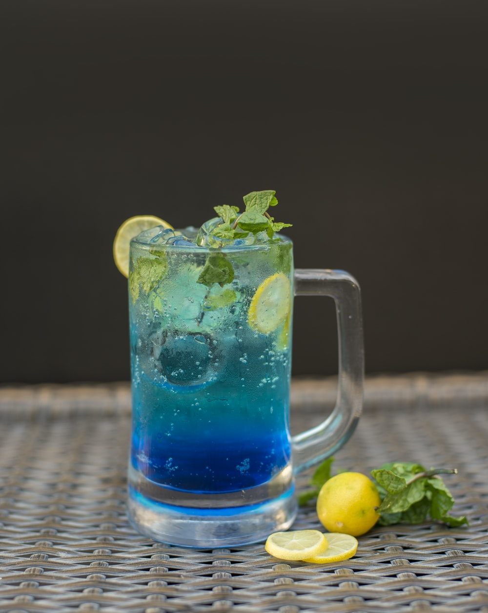 clear glass mug with blue liquid