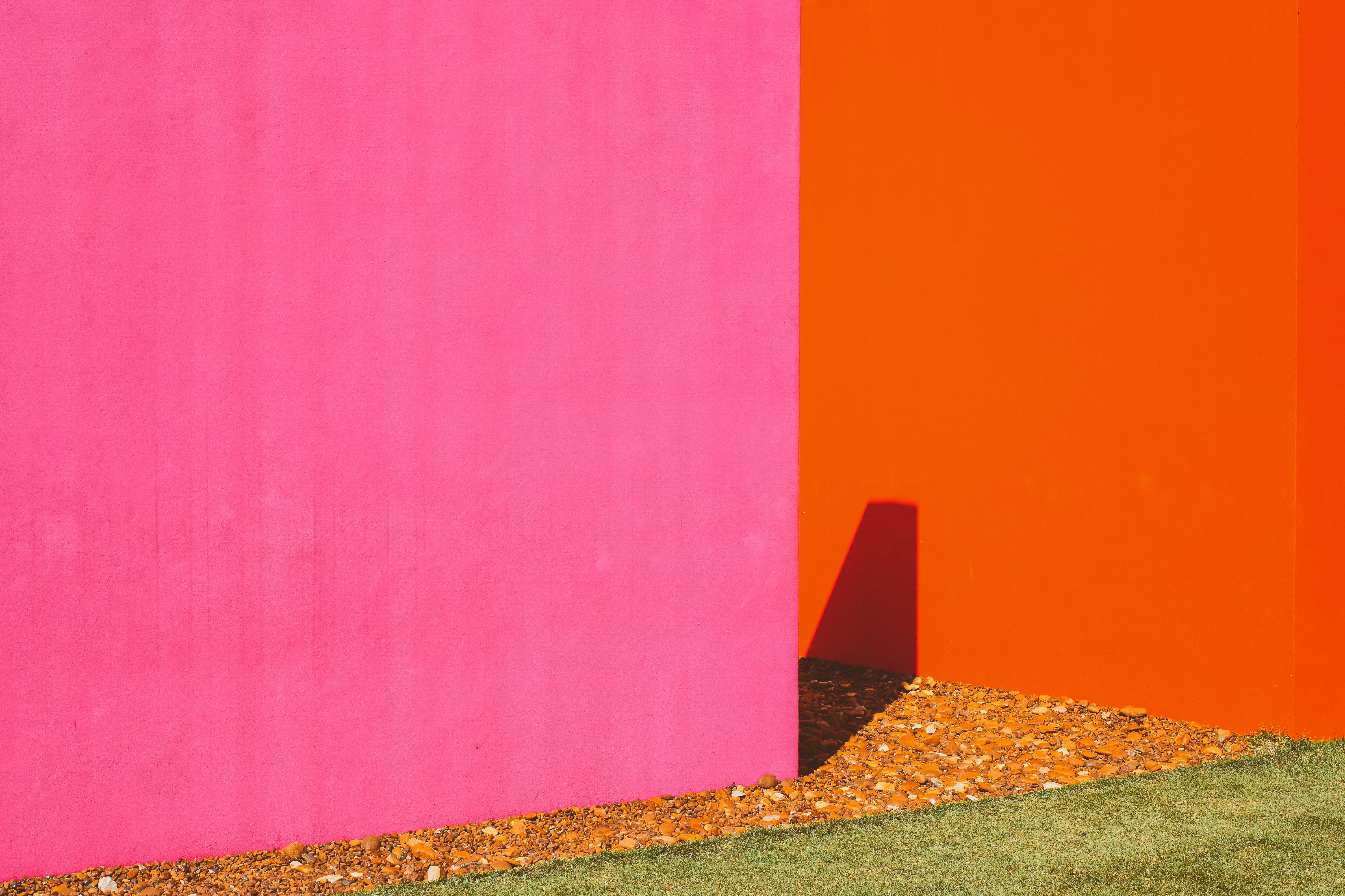 pink painted wall near orange painted wall