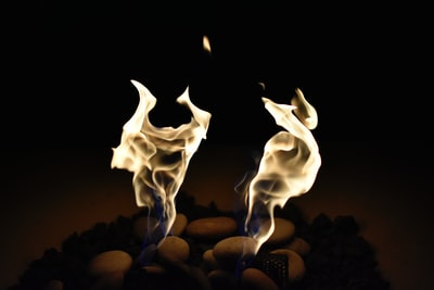 A heated argument between two demons materialized through fire plasma.