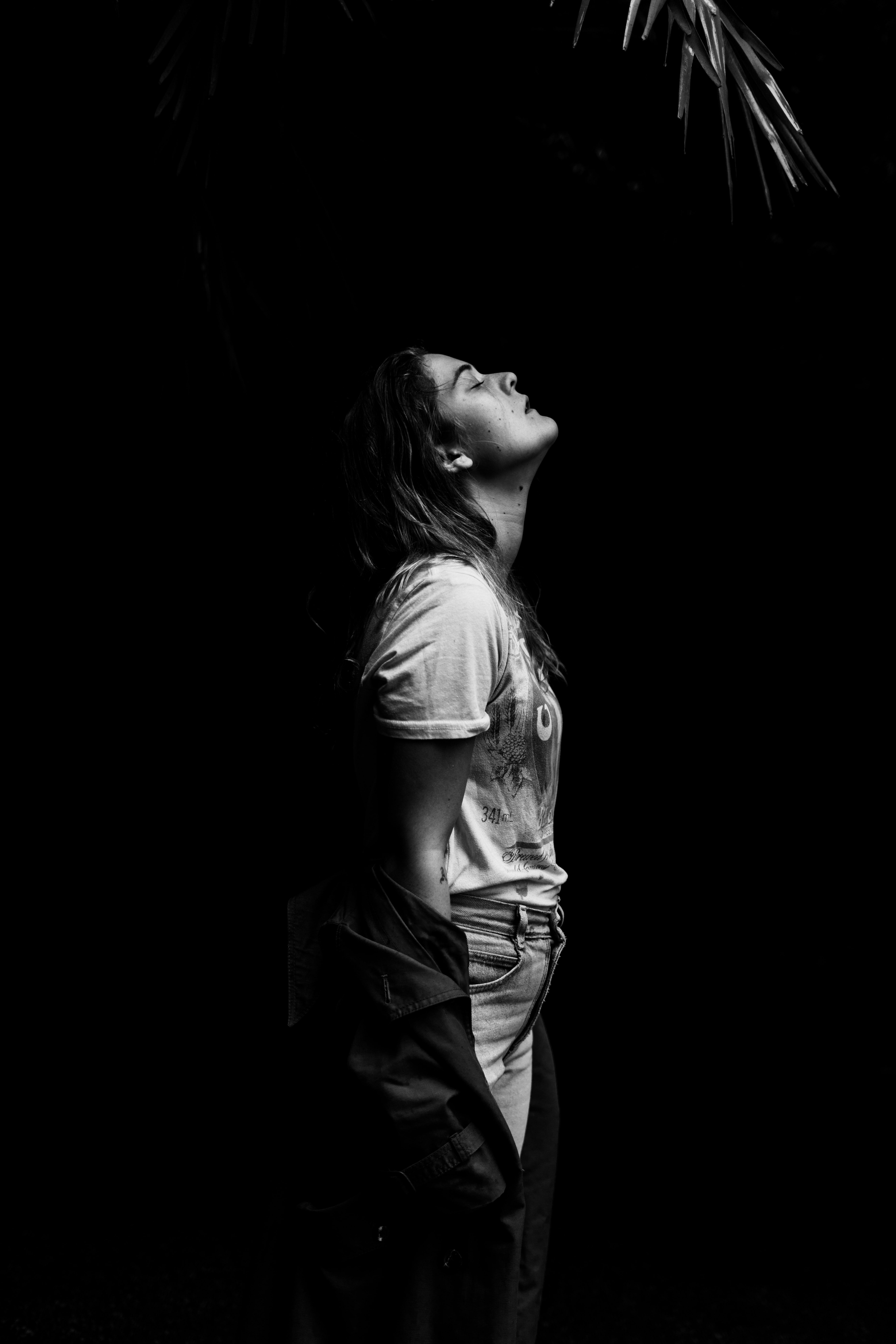 woman standing on dark place