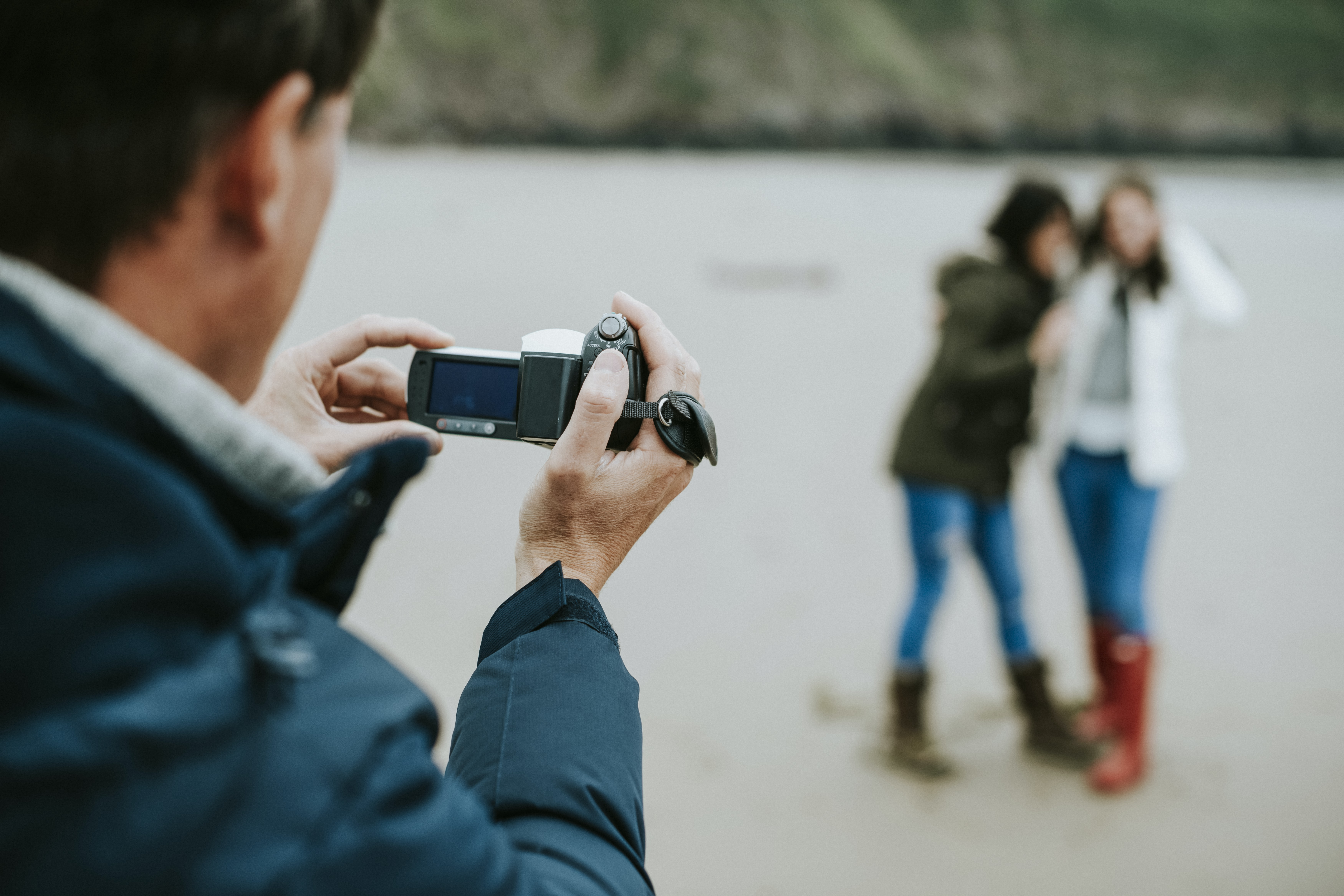 man taking video and picture