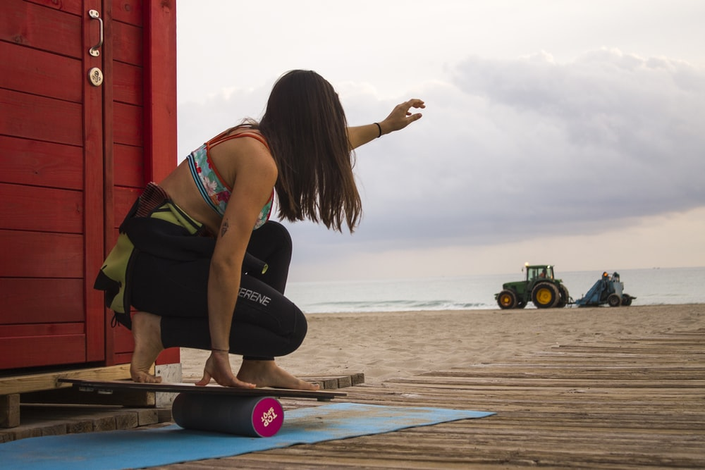 woman playing balance board