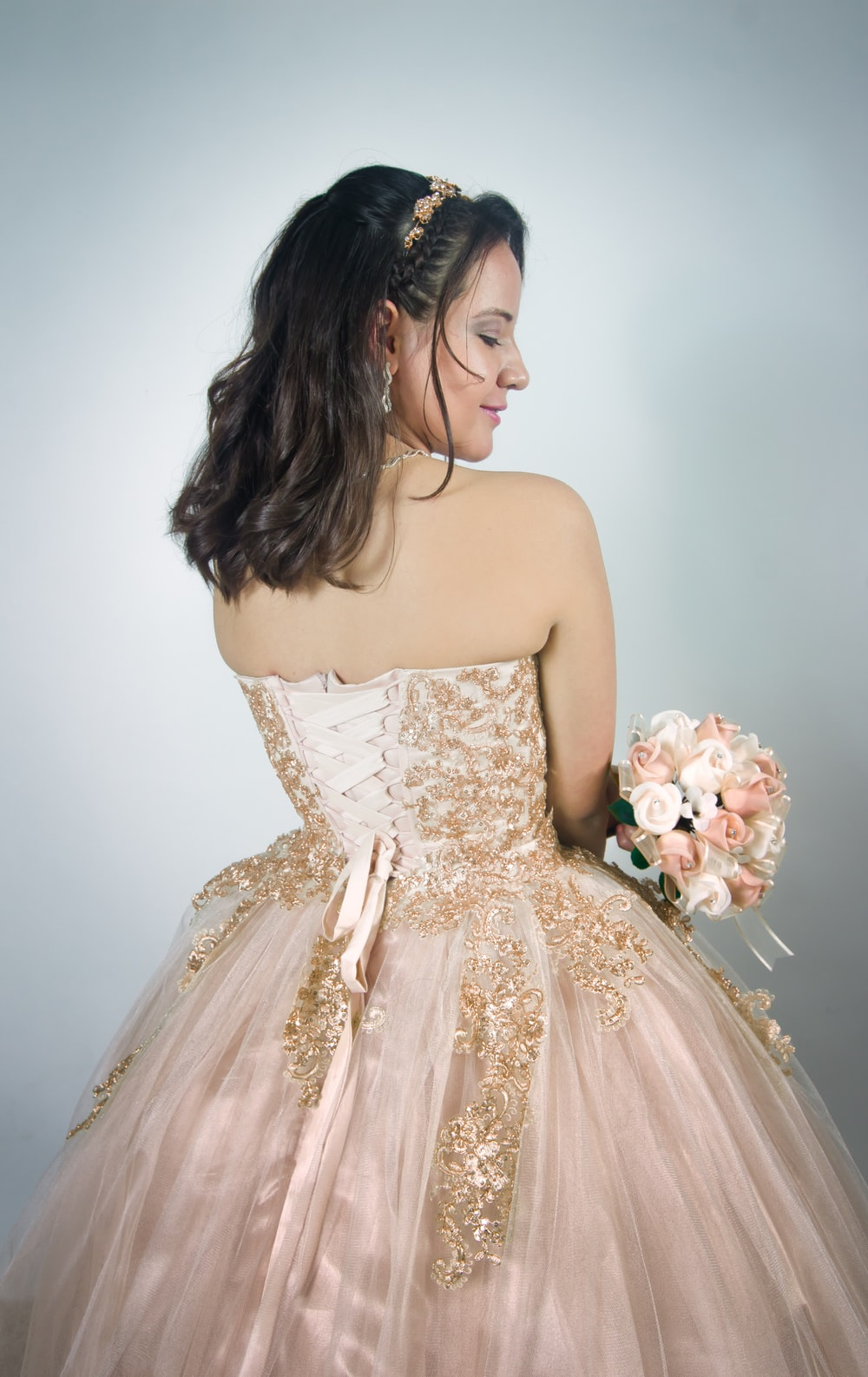 woman wearing pink strapless gown
