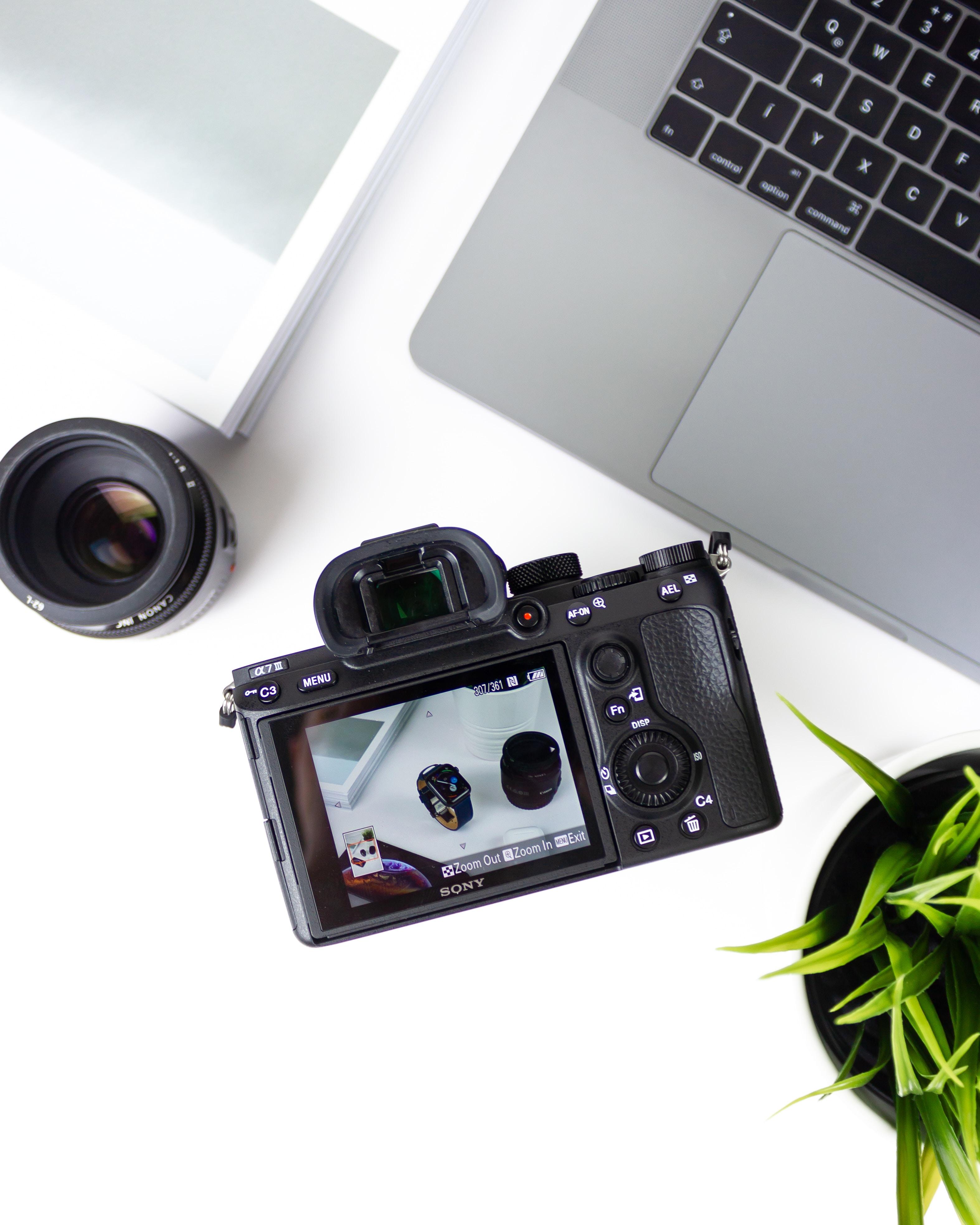 black bridge camera near laptop computer