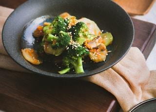 vegetable salad served on black ceramic plate